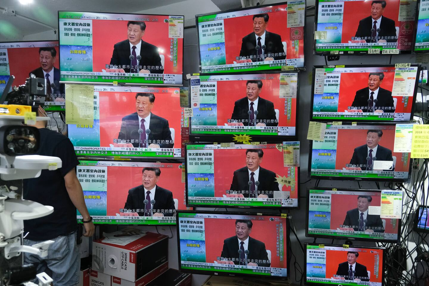 A news report on Chinese leader Xi Jinping's speech in the city of Shenzhen is shown on television screens inside a store in Hong Kong on Wednesday.