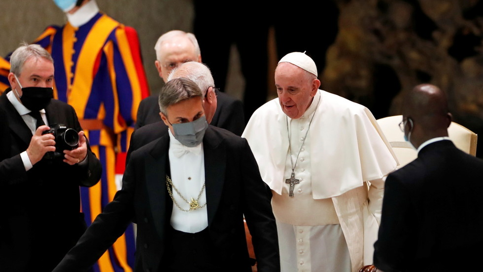 Pope Francis sparks criticism as he goes maskless at public event day after staff promise they are 'working on it'